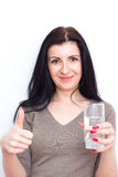 Smiling female model portrait with water glass. Beautiful girl. Young woman drink water. Stock Photography