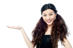 Smiling female model presenting something Royalty Free Stock Photo