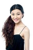 Smiling female model presenting something Royalty Free Stock Image