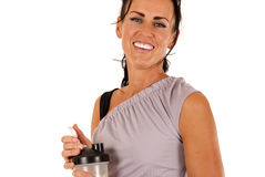 Smiling female model with water bottle after workout Stock Photo