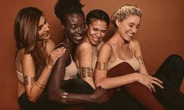 Free Smiling Female Models With Different Skins Royalty Free Stock Photo - 106980155