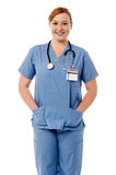 Smiling female nurse standing with stethoscope Royalty Free Stock Photo