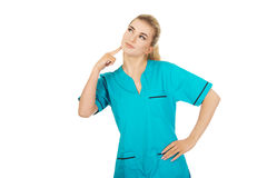 Smiling female nurse thinking about some idea Stock Photography