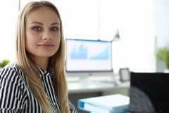 Smiling female in office royalty free stock photos
