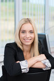 Smiling female office worker Stock Images