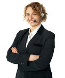 Smiling female operator with crossed arms Royalty Free Stock Images