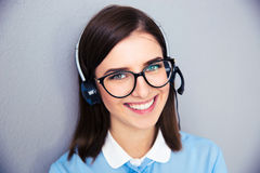 Smiling female operator with phone headset Stock Photography