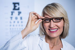 Smiling female optometrist wearing spectacles Royalty Free Stock Photo