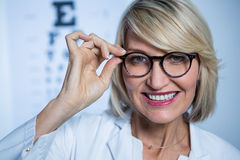 Smiling female optometrist wearing spectacles Stock Photography