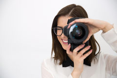 Smiling female photographer with camera Stock Images