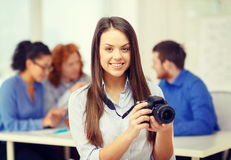 Smiling female photographer with photocamera Stock Photography