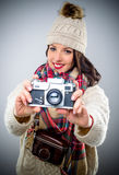 Smiling female photographer with a vintage camera Stock Image