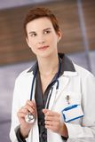 Smiling female physician in smock Royalty Free Stock Photos