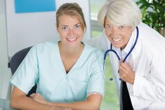 smiling female physiotherapist and doctor