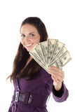 Smiling female with pile of dollar Royalty Free Stock Photo