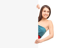A smiling female posing on a blank panel Royalty Free Stock Photo