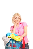 A smiling female posing with a laundry basket Stock Photo