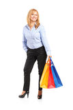 Smiling female posing with shopping bags Royalty Free Stock Image