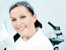 Smiling female researcher holding test tube Stock Photography