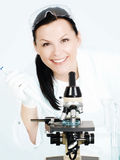 Smiling female researcher working on micr Royalty Free Stock Image