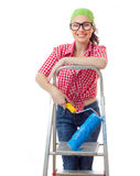 Smiling female with roller. Standing on ladder, isolated on white Royalty Free Stock Photo