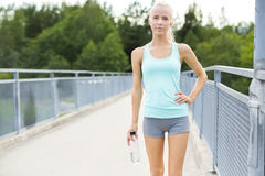 Smiling female runner taking a break after running Royalty Free Stock Photography