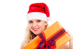 Smiling female Santa with Christmas gift Stock Photo