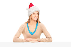 Smiling female with santa claus hat Royalty Free Stock Images