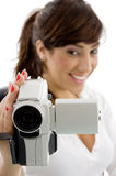Smiling female shooting with handy camera Royalty Free Stock Image