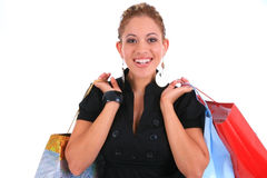 Smiling female shopper holding shopping bags Stock Photo