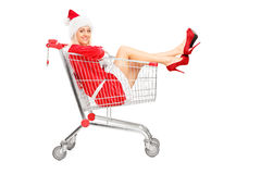 Smiling female in a shopping cart Royalty Free Stock Image