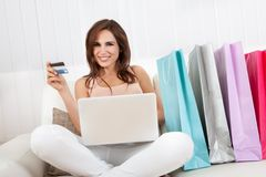 Smiling Female Shopping Online Royalty Free Stock Photos