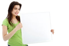 Smiling female. Showing a blank white board in a close up portrait stock photo