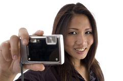 Smiling female showing camera Stock Photos