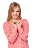 Smiling female showing heart with hands stock images