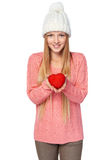 Smiling female showing heart shape. Smiling female showing red heart shape, over white background royalty free stock photos