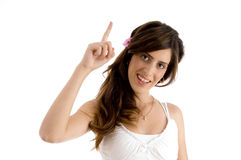 Smiling female showing index finger Stock Images