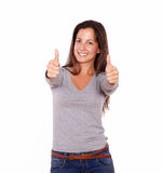 Smiling female showing positive sign with fingers Stock Photography
