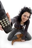Smiling female showing remote Royalty Free Stock Image