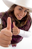 Smiling female showing thumbs up Stock Photos