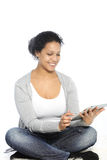 Smiling female. Sitting on the floor and browsing using her ipad Stock Photos