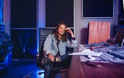 Smiling female sound technician in recording studio Royalty Free Stock Photo