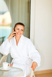Smiling female speaking phone on terrace Royalty Free Stock Photo