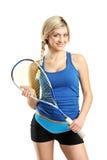 Smiling female squash player posing stock image