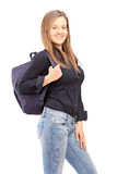 A smiling female student with a backpack Stock Images