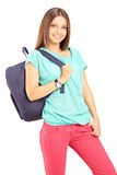 Smiling female student with a backpack looking at camera Stock Photo