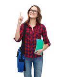 Smiling female student with bag and notebooks Stock Image