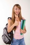Smiling female student with books in hands Stock Photo