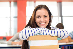 Smiling female student in classroom Stock Images
