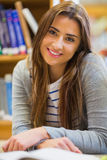 Smiling female student in the college library Royalty Free Stock Image